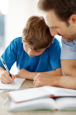 Buy stock photo Portrait of a young father helping his child to do homework - Indoor