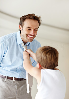 Buy stock photo Portrait of a little boy helping his father in wearing necktie - Indoor