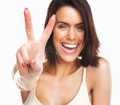 Buy stock photo Young excited woman making victory sign isolate on white background