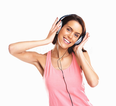 Buy stock photo Young mixed race woman listening to music in headphones against white background