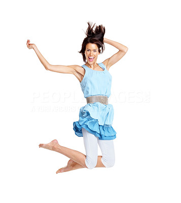 Buy stock photo Portrait of a pretty young woman jumping in joy over white background