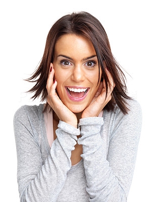 Buy stock photo Portrait of an excited young woman holding her face against white background