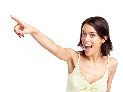 Buy stock photo Portrait of a excited young woman pointing towards copyspace  over white background