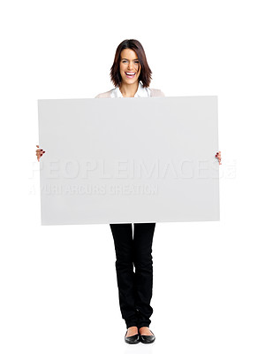 Buy stock photo Portrait of a happy young woman holding a blank billboard over white background