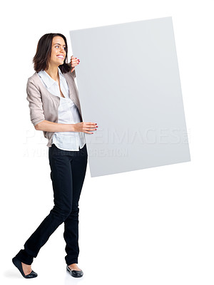 Buy stock photo Full length of a happy young woman advertising with an empty billboard over white background