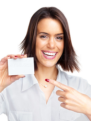 Buy stock photo Portrait of a happy young female pointing towards small business card against white background