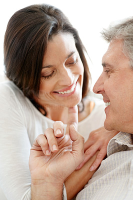 Buy stock photo Portrait of a lovely mature couple looking at each other and smiling
