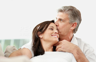 Buy stock photo Mature man kissing his beautiful wife on forehead - Indoor