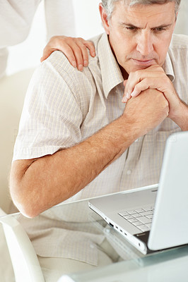 Buy stock photo Portrait of a middle aqed man looking at laptop in tension