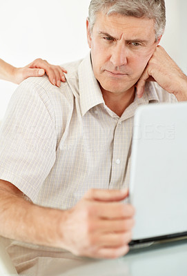 Buy stock photo Portrait of a mature man with a laptop lost in thought
