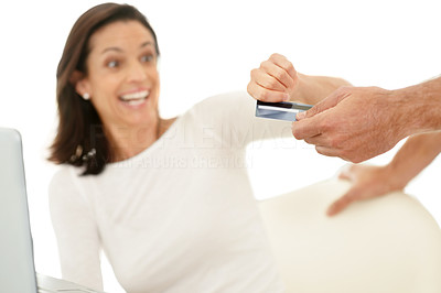 Buy stock photo Portrait of a excited woman taking credit card from man's hand for online shopping