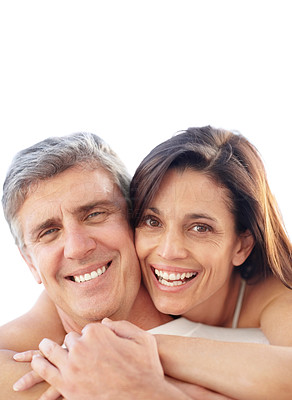 Buy stock photo Portrait of a lovely mature woman embracing her husband from behind and smiling