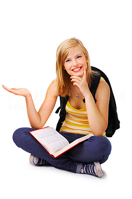 Buy stock photo Portrait of a young cute student with a book, holding out her hand. This isolate was taken in our studio.