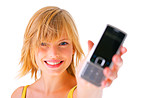 Young girl holding out phone