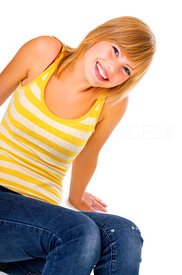 Buy stock photo Young woman sitting against a white background smiling