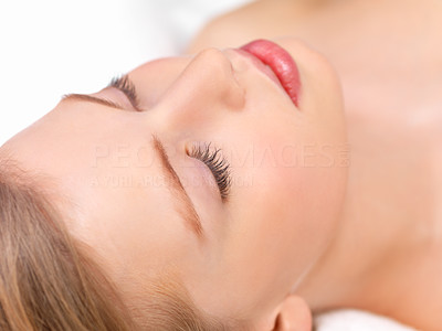 Buy stock photo Topview of a beautiful young woman with flawless sking lying with her eyes closed