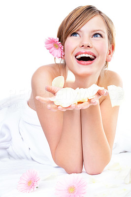 Buy stock photo Young woman holding rose petals, laughing, looking up