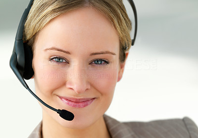 Buy stock photo Close-up portrait of a young beautiful business woman smiling at you wearing a headset