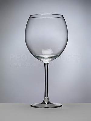 Buy stock photo Shot of an empty wine glass