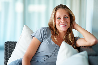 Buy stock photo Portrait of a charming young woman relaxing on sofa at home - Indoor