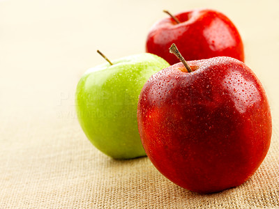 Buy stock photo Shot of red and green apples on cloth.
