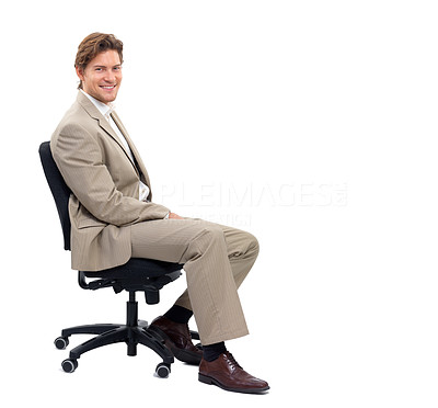 Buy stock photo Cheerful young man sitting on chair against white background