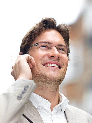 Buy stock photo Closeup of a cheerful businessman using mobile phone