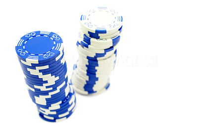 Buy stock photo Two leaning stacks of poker chips - one blue and one white