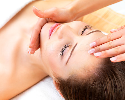 Buy stock photo Close up portrait of a beautiful young woman receiving a professional facial massage