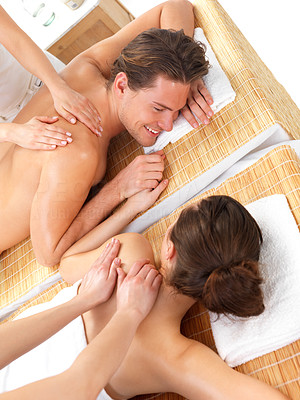 Buy stock photo Close up portrait of a romantic couple, on a spa holiday, having a back massage