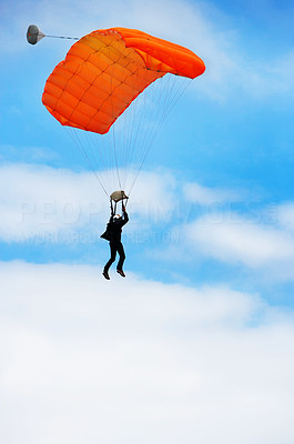 Buy stock photo A parachutist in the air against the open skies