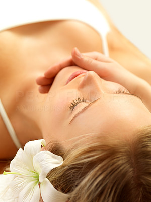 Buy stock photo Close-up of a beautiful woman getting a face massage - Health and beauty