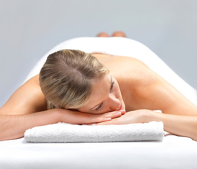 Buy stock photo Portrait of a beautiful woman relaxing, awaiting a massage at the day spa