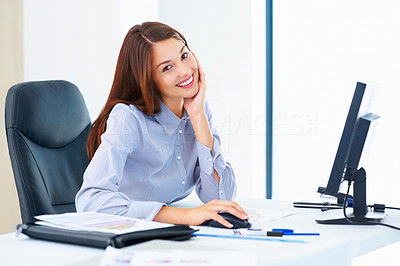 Buy stock photo Portrait of beautiful female executive sitting at an office table and smiling