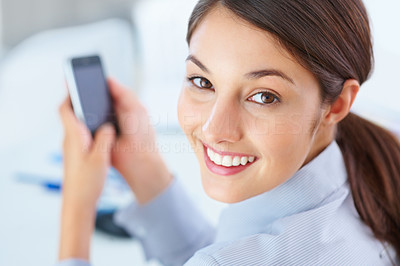 Buy stock photo Closeup of businesswoman using cellphone and giving you an attractive smile