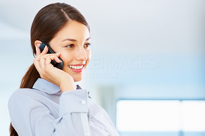 Buy stock photo Cute young female executive having friendly conversation on cellphone