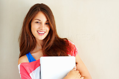 Buy stock photo Portrait of young charming girl holding laptop and smiling