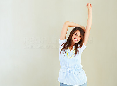 Buy stock photo Portrait of pretty woman standing near wall and enjoying the moment