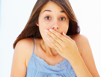 Buy stock photo Closeup of surprised young woman covering mouth with hand