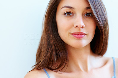 Buy stock photo Closeup of attractive young woman looking confident - copyspace
