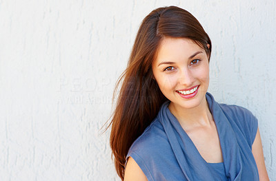 Buy stock photo Beautiful young woman standing against wall - copyspace