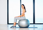 Woman relaxing on fitness ball