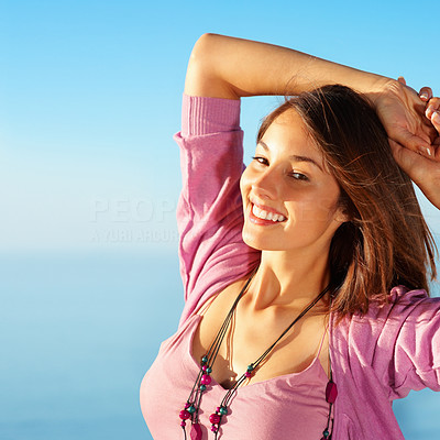 Buy stock photo Portrait of beautiful young woman resting her hands on head - copyspace