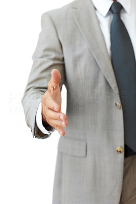 Buy stock photo Cropped image of a businessman hand held out to shake hand against white background
