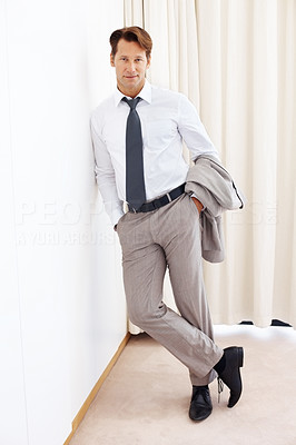 Buy stock photo Portrait of a confident businessman leaning over a wall