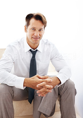 Buy stock photo Portrait of a successful businessman sitting on the staircase