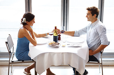 Buy stock photo Portrait of happy young couple on date in restaurant
