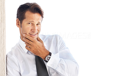 Buy stock photo Portrait of a smiling young businessman leaning on the wall staring at you