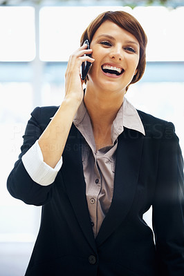 Buy stock photo Female executive standing and talking on cell phone