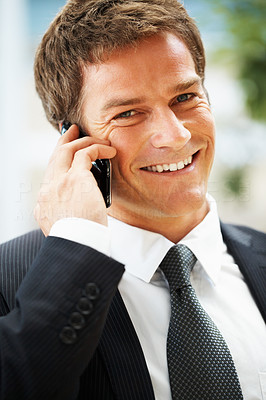 Buy stock photo Closeup of handsome executive smiling while on cell phone
